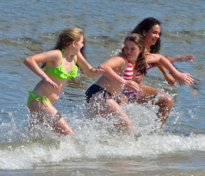 3 handsome coed girls in wet bikini