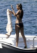 Zoe Saldana Goes Topless on a Boat