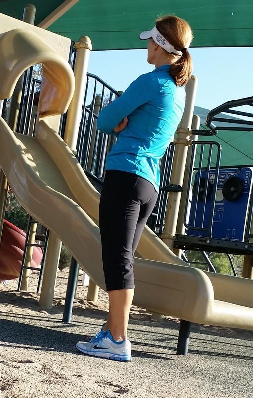 athletic milf in tight black gym pants at park