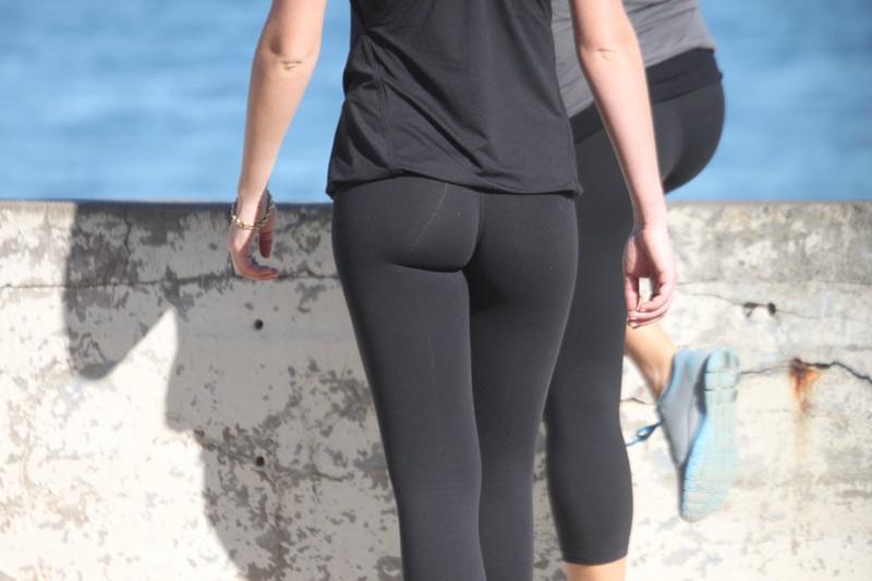 2 hot butts in black leggings