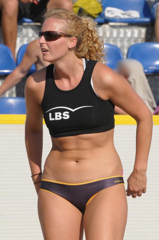 beach volleyball curvy blonde lady in candid swimwear