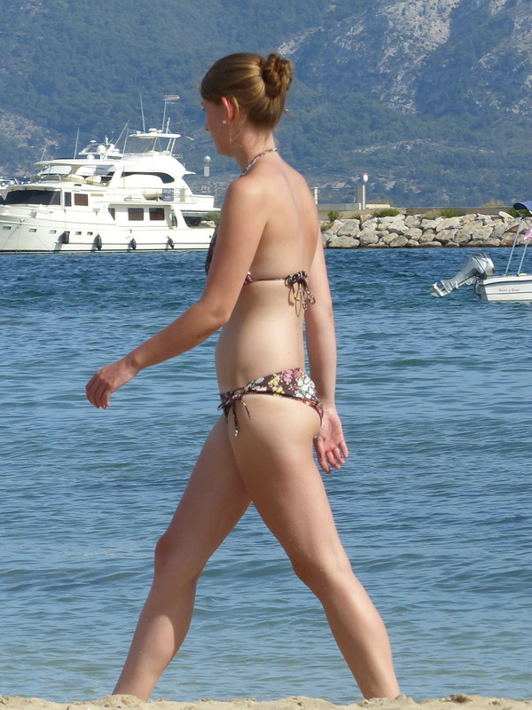 sexy bikini trio wander past me on beach