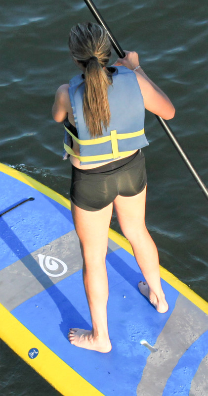 paddle boarder lady in black spandex shorts
