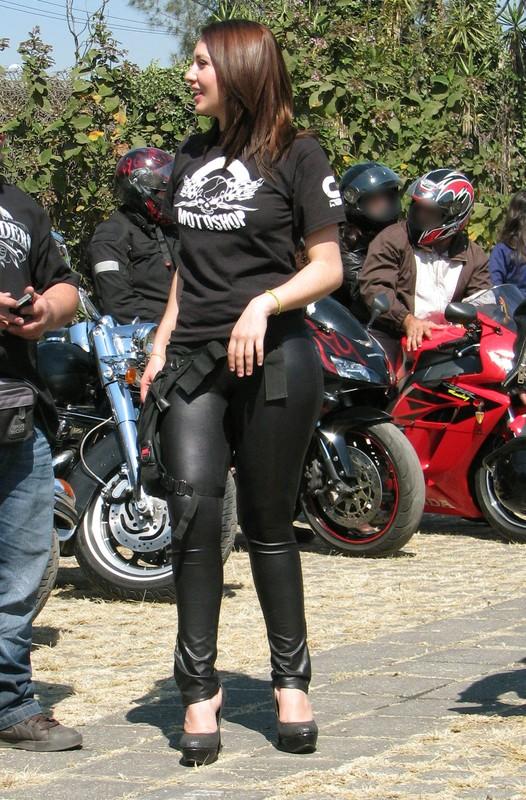 stunning biker lady in leather black pants
