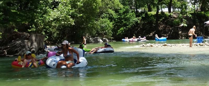 river tourist girls in wet swimsuits & bikinis