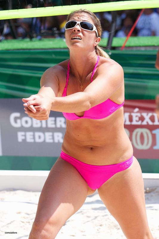 beach volleyball girl in pink bikini