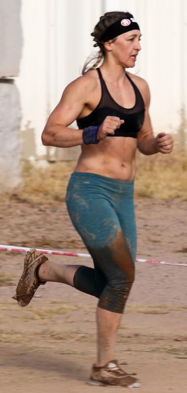 mud runner lady in dirty asics leggings