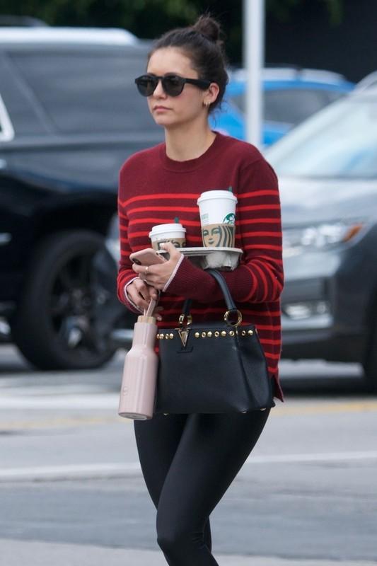 canadian actress Nina Dobrev in black leggings