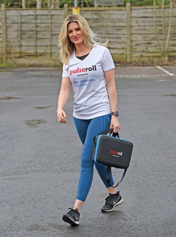 blonde hottie Sarah Jayne Dunn in blue leggings