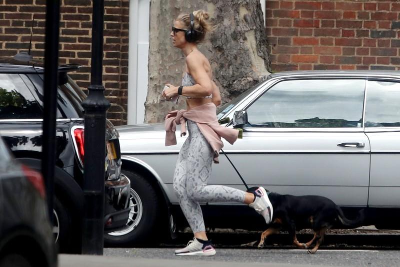 beautiful jogger Vogue Williams in pretty gym uniform