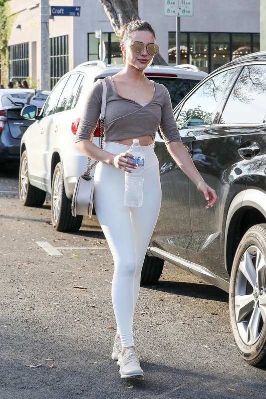 sexy babe Olivia Culpo in white skin tight leggings