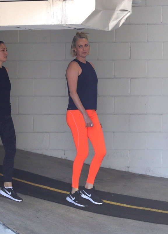 south african actress Charlize Theron in orange yogapants