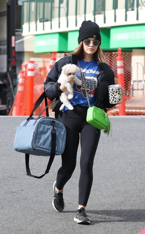 attractive babe Lucy Hale in black leggings