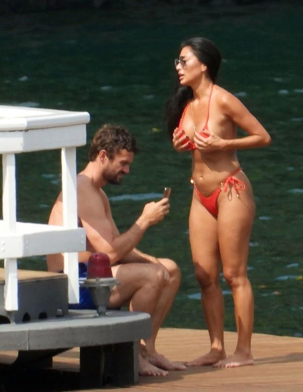 handsome babe Nicole Scherzinger in red thong bikini