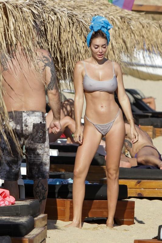 pretty babe Elena Morali in candid white bikini